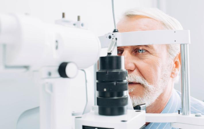 man receiving an advanced eye exam