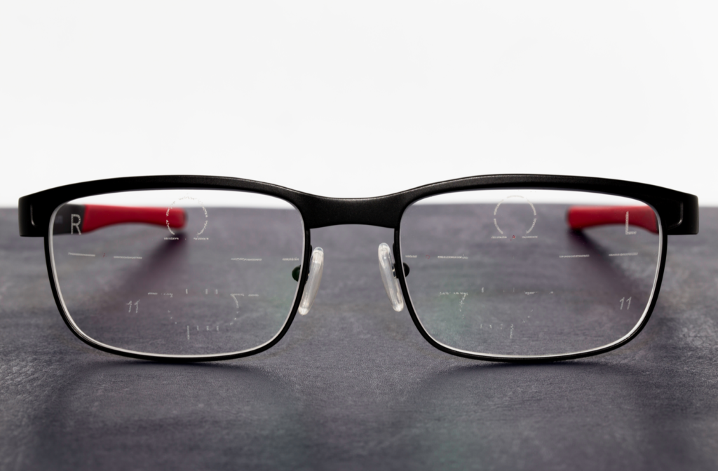 Frames with progressive lenses resting on grey desktop